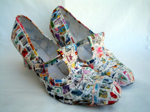 image of sculpture of shoes made from postage stamps