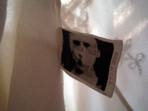 image of miniature portrait on dress label